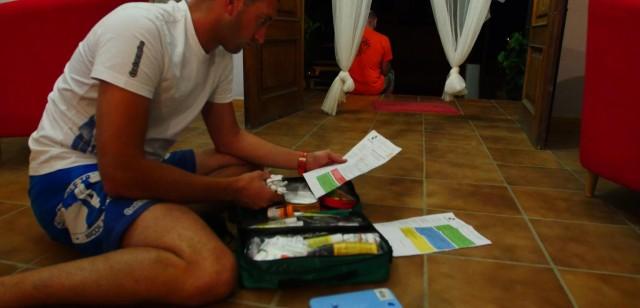 nicolas jarossay checking his first aid kit