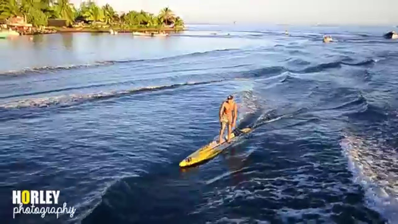 Surfing a Boat Wave in Teahupoo, Tahiti