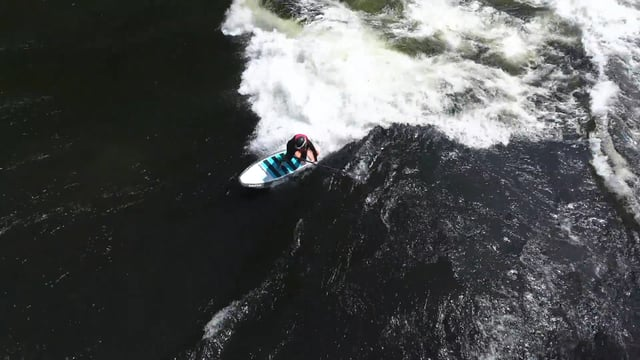 Stand Up Paddle River Surf by Brittany Parke