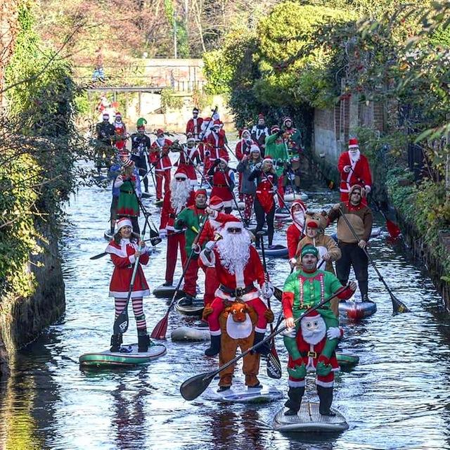 The Story Behind The Original Santa SUP Parade