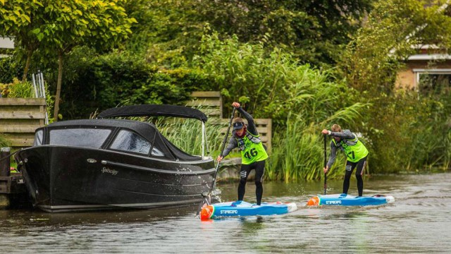 Daniel Hasulyo powers ahead of his brother during a stage of the 2017 SUP 11 City Tour in The Netherlands