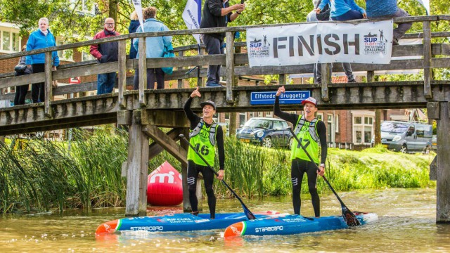 Daniel and Bruno Hasulyo passing the finish line at the 2017 SUP 11 City Tour in The Netherlands
