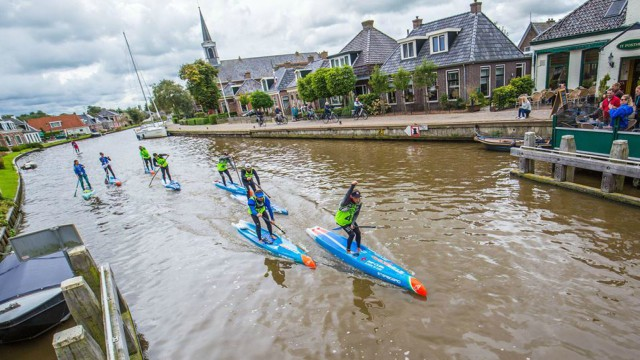 Daniel Hasulyo powers through a canal in Friesland, The Netherlands during the 2017 SUP 11 City Tour