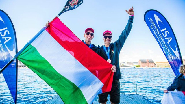 Daniel Hasulyo celebrates his brother Bruno's long distance title with him at the 2017 ISA World Sup and Paddleboard Championship in Denmark