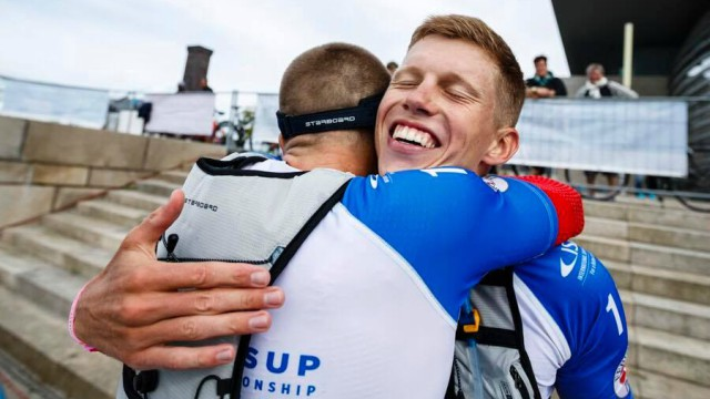 Daniel Hasulyo hugs his brother Bruno at the 2017 ISA World SUP and Paddleboard Championship in Denmark