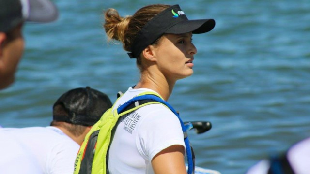 Lena Guimarães Ribeiro waits on the sidelines in Hawaii