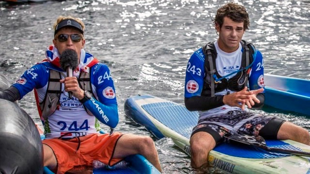 Connor Baxter gives interview, as Hawaii teammate Mo Freitas stares on
