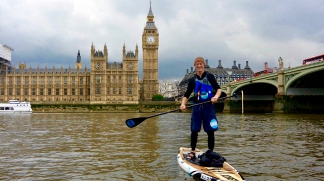 Paul Hyman of Active360 paddleboarding in front of Westminster and Big Ben