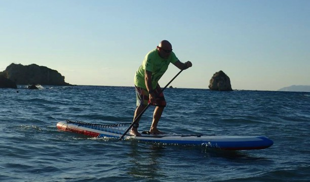 Tim Rowe enjoying a spot of stand up paddle