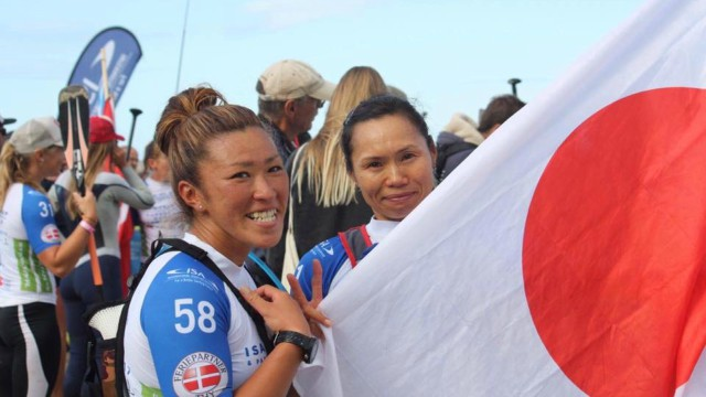 SUP rider Yuka Sato poses with the Japanese flag at the 2017 ISA World SUP Championship in Denmark