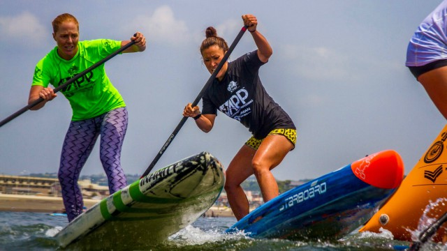 SUP rider Yuka Sato competes at an event in Hawaii in 2016
