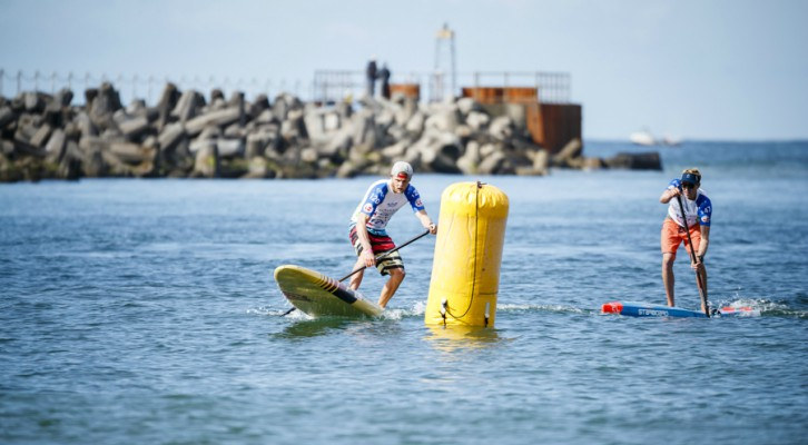 Connor Baxter circumvents a buoy at a race during the 2017 ISA World Championship in Denmark