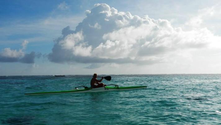 Garrett Fletcher practises aboard his outrigger canoe