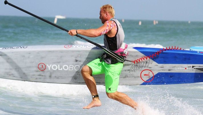 Garrett Fletcher dashes to the shore during a SUP race while under contract with Yoloboard
