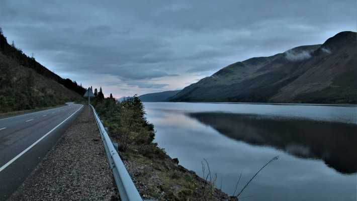 Brooding rain clouds assemble over Loch Lochy in Scotland