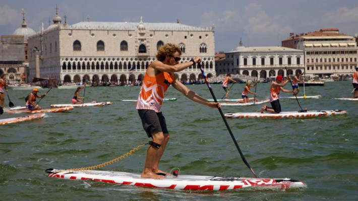 Paolo Marconi competes at a stand up paddle event in Venice, Italy