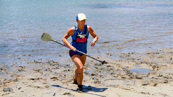 Angela Jackson makes a dash for the finish line in a race of the Australian National SUP Championship