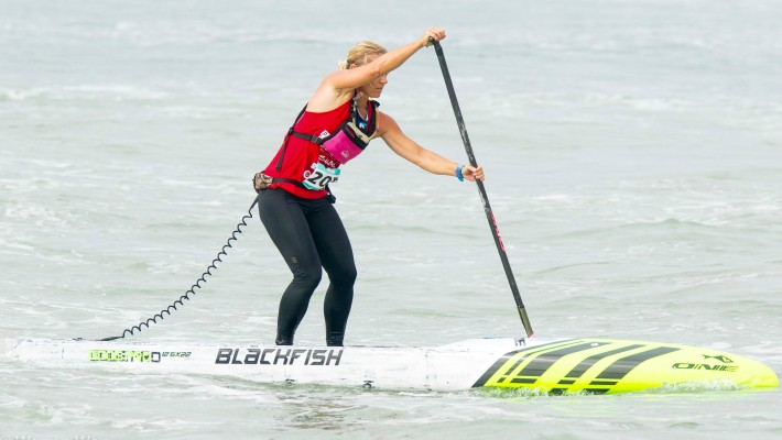Angela Jackson competes in a competitive event aboard one of her own brand ONE Stand Up Paddle's Blackfish model