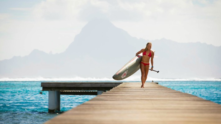 Annabel Anderson walks along the boardwalk in Tahiti
