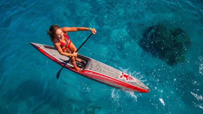 Annabel Anderson aboard her SUP board in Tahiti