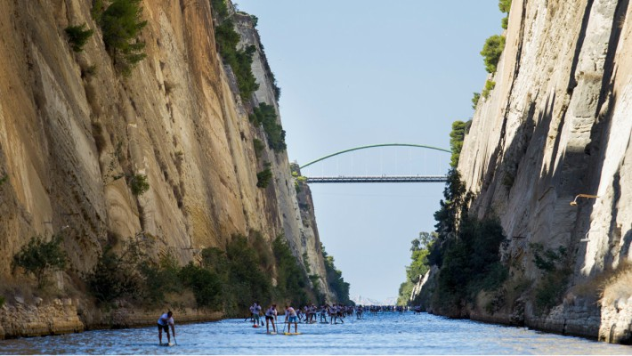 Participants make their way through the impressive depths of the Corinth Canal at the 7th Annual Corinth Canal SUP Crossing 2017 in Greece