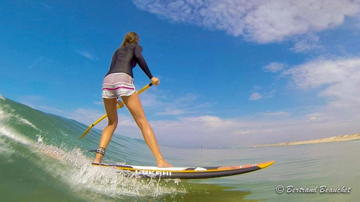 French SUP Surf Champion Delphine Macaire riding the swell in Aquitaine, France