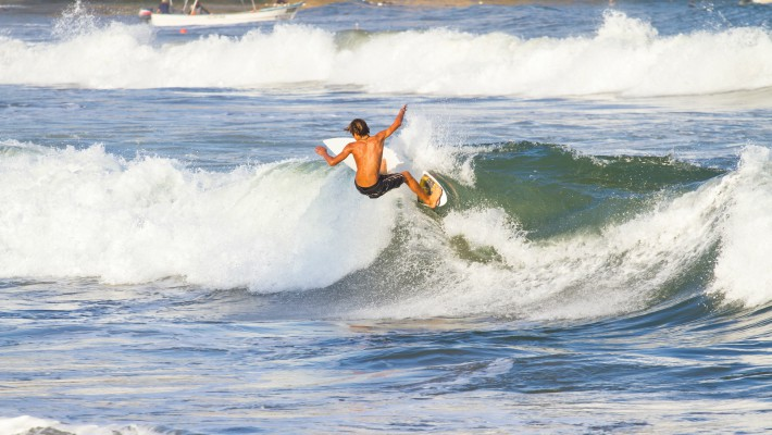 A youngster takes advantage of Sayulita's famously consistent wave conditions