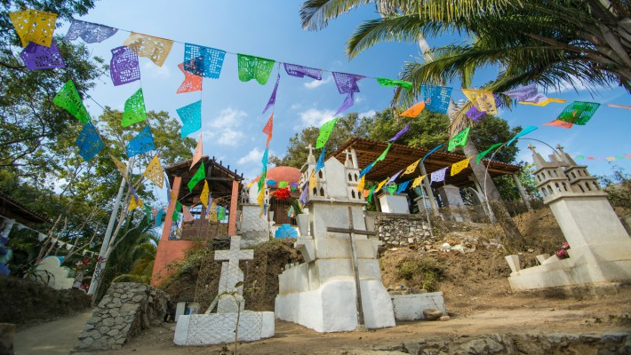Traditional decorations go up at Sayulita's famous Playa de los Muertos beach
