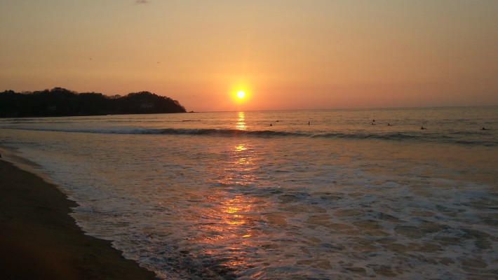An idyllic sunset by the beach in Sayulita, Mexico