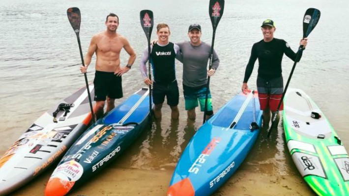 Michae Booth is in good company training for a competitive event with Starboard SUP teammates