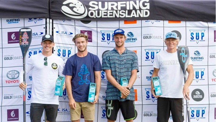 Michael Booth poses with fellow SUP riders, including rising star Lincoln Dews, upon winning the 2017 Australian SUP Championship