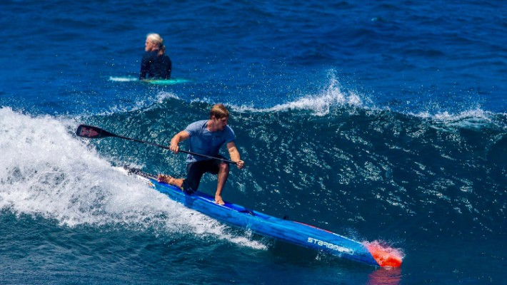 SUP rider Michael Booth takes on the waves during a Starboard SUP race session
