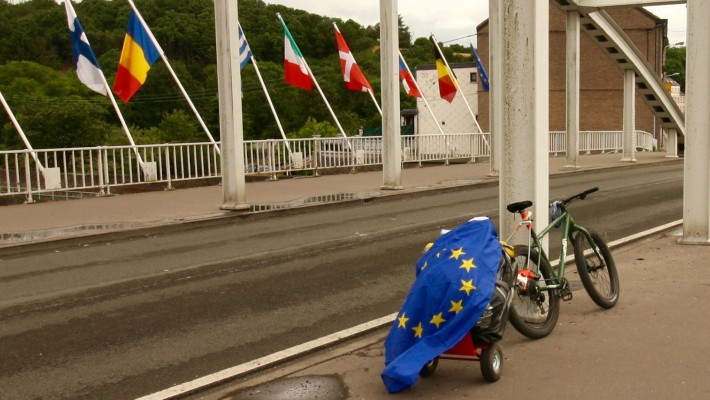 Flag time! Mark Hines stops at a bridge in France, flaunting the European Union flag