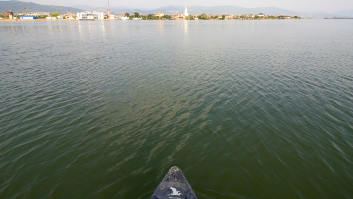 Mark Hines faces a small waterside town in Serbia during his SUP expedition across Europe's largest waterway after the Volga