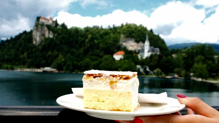 You can enjoy a slice of kremšnita, one of Slovenia famed sweet delicacies, while admiring the views over Lake Bled