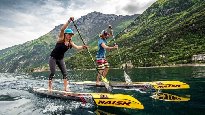 Slovenian all-star SUP rider Manca Notar trains in Slovenia alongside Casper Steinfath at the foot of the Alps in Slovenia