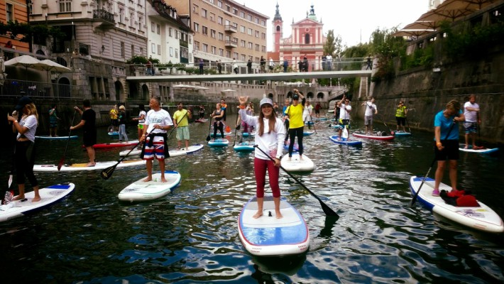 Slovenian SUP rider Manca Notar awaits the beginning of a stage in a SUP race in the country's capital, Ljubljana