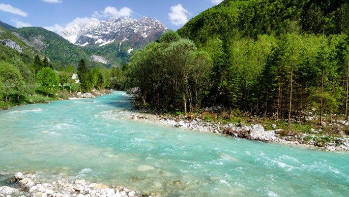 The clear blue waters if one of Slovenia's most treasured UNESCO World Heritage sites, the Soca River