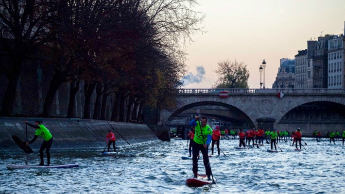 Paddlers pick up the pace along the Seine at the 2016 Nautic SUP Paris Crossing