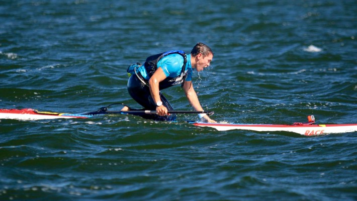 Paul Lenfant aboard his SUP boards during a competition