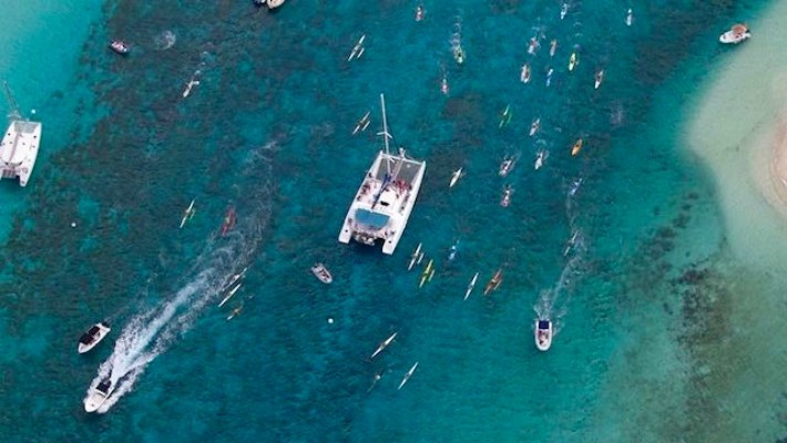 SUP riders battle it out on a downwind run, as seen from above, at the 2017 edition of ZE RACE in Guadeloupe