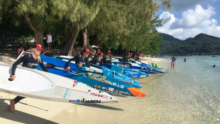 Athletes, including Starboard SUP rider Olivia Piana, set out for a SUP trial as part of Ironmana 2017