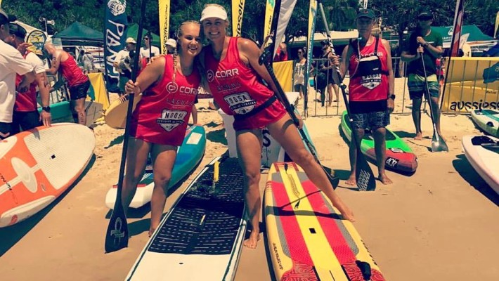 Karla Gilbert poses with a fellow paddler above her Naish SUP board