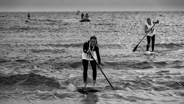 French national SUP vice-champion Inès Blatge dashes to the shore during a race as part of the French national SUP championship 2017