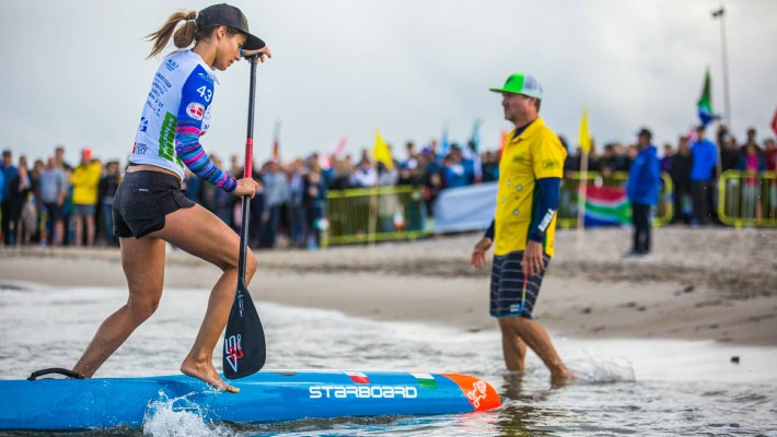 Olivia Piana arrives at the finish line of the long distance race at the ISA World SUP Championship in Denmark in 2017, nabbing second place
