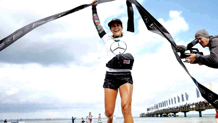 Olivia Piana arrives at the finish line at trial as part of the 2017 Mercedes-Benz SUP World Cup in Germany