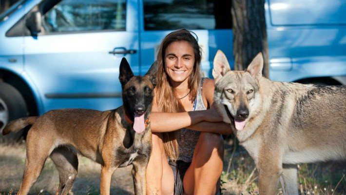 Olivia Piana accompanied by her belloved wolfhounds near her home in France