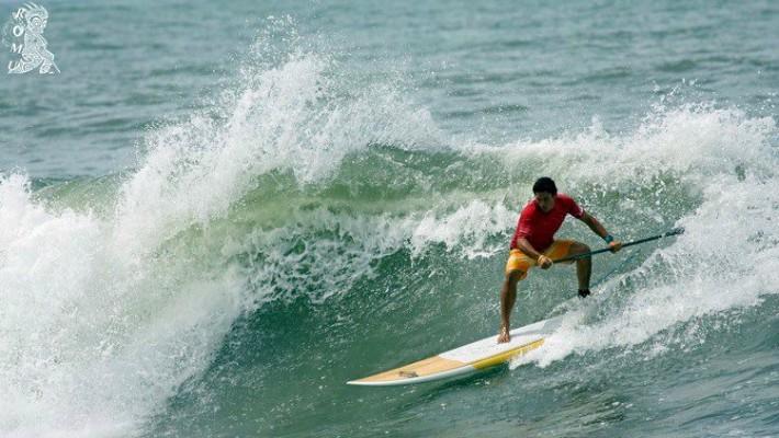 Tehotu Wong rides some waves in his homeland of Tahiti