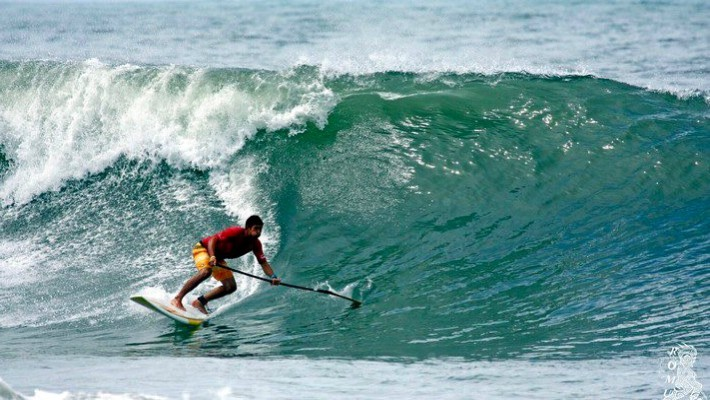 Tehotu Wong shows off hi SUP surf skills near Teahupo'o, Tahiti, French Polynesia